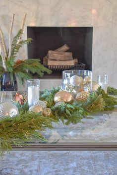 A Silver and Gold Christmas Centerpiece with Evergreens on glass coffee tables Christmas Is Over, Real Christmas Tree, Christmas Mantels, Gold Christmas, Christmas Balls, Simple Christmas, Christmas Home, Tree Centerpieces, Christmas Centerpieces