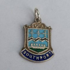 Southport Travel Shield Charm - Sterling Silver Enamel Vintage Bracelet Charm, Pendant, Charm Necklace. Lancashire, England. by LittleVintageCharmCo on Etsy