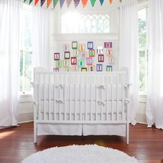 Sometimes the best way to make a space really pop is to create the absence of color. An all-white space is inherently chic, but can also be a little dull for a baby who is trying to take in every new bit of their world. We love the way that adding color in a concentrated area makes this room pop. This is a great design for renters who can't paint the walls. Rather than try to bring in tons of color, bring in more white to match the walls, then just choose a few key pieces to make a…