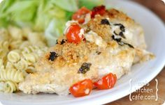 Cheesy basil stuffed chicken.  Delicious...(I added mushrooms with cherry tomatoes in the mix)