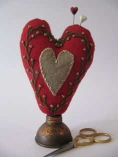 Red heart Pincushion -  Hand dyed Wool and embroidery Heart ScissorKeep - the base looks like a tiny oil can...like the one I have sitting around doing nothing in particular