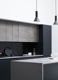 A Forgotten Warehouse Is Reborn Into a Light-Filled London Home - Photo 7 of 12 - A black marble backsplash contrasts effortlessly with the white walls and light wood panels throughout the home. Flat panel cabinets add an extra modern flair. Home Decor Kitchen, Kitchen Interior, Kitchen Wood, Kitchen Grey, Kitchen Backsplash, Kitchen Ideas, Küchen Design, Door Design, Interior Design