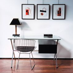 With glass, chrome-plated steel and painted wood, Franco Albini's 1958 floating pedestal desk demonstrates a commitment to both modernism and traditional artisanship by utilizing raw materials. Two-drawer pedestal available in black stained oak or white lacquer. Frame and legs in square steel tube with chrome finish.