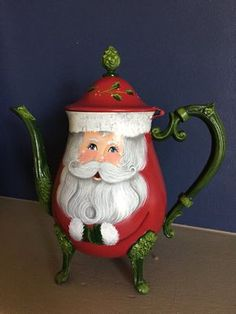 I hand painted a cute Santa with sparkling eyes on an old silver teapot. On the front, he has a face, arms and mittens. Christmas China, Christmas Tea, White Christmas, Christmas Tablescapes, Christmas Decorations, Painted Pots, Hand Painted, Teapot Crafts, Teapots Unique