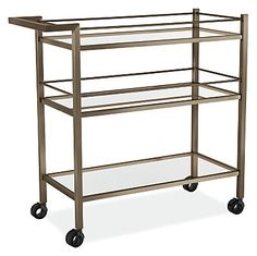 Stainless steel and tempered glass combine to create this functional, modern bar cart. Smooth rolling casters make it easy to wheel cocktails and snacks from room to room. Three shelves give you plenty of room to store bar tools and glasses.
