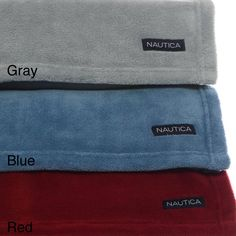 Envelop yourself in warmth and comfort with this microfleece blanket from Nautica, available in red, blue and grey. The material resists pilling that can diminish the look and integrity of material, and is conveniently machine washable.