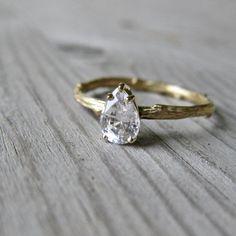 love this ring ... same shape diamond as my engagement ring ... but love the twig band. So me - natural but with a little bling element {to be different}