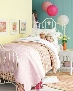 Golden pale yellow, teal blue and pink girl's bedroom