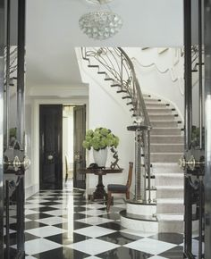 Stunning, entry with timeless black and white floor tiles ~Pieter Estersohn Photography