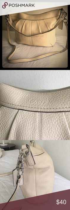 Coach Pebbled Leather Pleated Ashley Beautiful cream colored Pebbled leather Pleated Ashley Two Way Convertible Bag. It does have signs of wear, which are captured in photos. They are only noticeable very close up. Still a beautiful bag with a lot of life left. Coach Bags