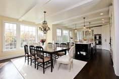 open kitchen/dining. love the beams