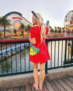 The Flounder Little Mermaid Purse really makes it for this gorgeous shot!  #Regram via @vandifair  Disney Style I Disney Outfit I Disney OOTD I Disney Park Outfit I Wear to Disney