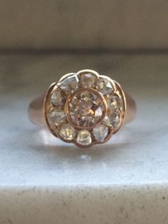 This beauty has sparkle for days. It is an antique diamond ring set in 18k gold. The central diamond is a large european cut diamond. This diamond