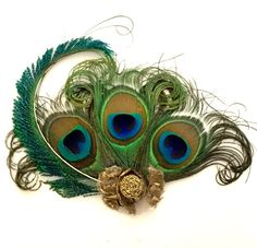 Gold peacock feather hair clip. by talulahblue on Etsy