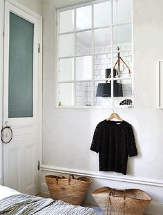 Internal windows and Mallorcan baskets in a charming Stockholm flat. Credits: Patric Johansson / Maria Löw.