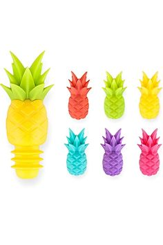 """Keep your party colorful and on trend with this tropical set of pineapple wine charms and bottle stopper. Bright colors ensure every glass gets some cheer and the silicone stopper preserves your bottle for the next round! Set includes: 6 wine charms and 1 stopper food and dishwasher-safe. Arrives in a gift box ready to take to your next party cheers! Dimensions:  stopper 3"""" x 1.5""""  charms:  1"""" x .5""""       Pineapple Wine Set by True Fabrications. Home & Gifts - Home Decor - Dining - Barware…"""