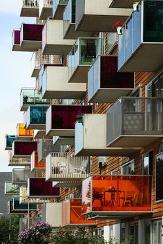Colorful Balconies, Creative Architecture, Commissioned by the Het Oosten Housing Association, Wozoco--built between 1994 and a building of 100 homes for those over 55 years. It is located in Ookmeerweg street in Amsterdam-Osdorp, Netherlands. Amazing Buildings, Amazing Architecture, Contemporary Architecture, Art And Architecture, Amsterdam Architecture, Installation Architecture, Unusual Buildings, Contemporary Building, Contemporary Apartment