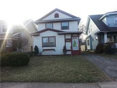 Buffalo Real Estate  - 365 Lisbon Ave, Buffalo, NY, 14215 UB Area * Roomy house * Large fenced yard * All 3 bedrooms & bath are upstairs * Some hardwood floors & carpet * Current tenant pays $900/mth & wants to stay * Owner anxious to sell * Dry basement with glass block windows * Lenox furnace - 3 yrs old * Hot water tank - 1 yr old *