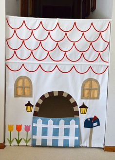 Little house in the Hallway!  Tension Rods and some fabric.....for those loooooong winter days ahead.