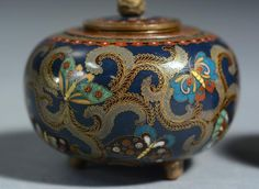Two fine Japanese Meiji cloisonné covered jars one with pierced lid