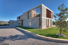 Stone House in Anavissos / Whitebox Architects | photo George Fakaros