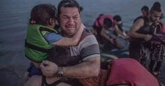 A Syrian refugee from Deir Ezzor, holding his son and daughter, breaks out in tears of joy after arriving via a flimsy inflatable boat crammed with about 15 men, women and children on the shore of the island of Kos in Greece, Aug. 15, 2015.   we want to build new way for life for every one  to start college and find better job no matter about the papers to sign in