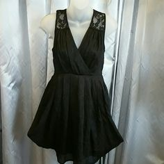 HP11/6H&M little black dress NEW This chic & sexy little black dress the back of dress is sheer lace (as seen in pic) with exposed gold zipper in the back!  new, never worn. 100% polyester Size 4 H&M Dresses