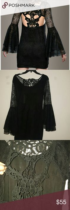 Spiderweb skull lace dress NWOT never worn spiderweb lace pattern dress. So cool, witchy boho vibe. Flared layered sleeves, crochet skull lace on the back. Zipper side Skulls Gothic  Goth Punk  Halloween  costume  Hot topic  Dollskill Hot Topic Dresses Mini