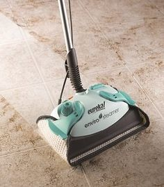 Eureka Enviro Hard-Surface Floor Steam, 313A - cleans with just hot water (220 degrees), no chemicals, 25' cord, 5 lbs, holds 20 oz water. Cleans hardwood, tile, linoleum, & laminate