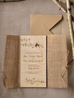 WEDDING INVITATION ... lazer cut wood ... delicate branches with lovebird pair ... burlap cover ... twine wrap ...