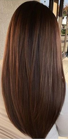 Sleek brunette with minimal caramel highlights