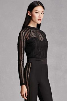 A knit two-piece set featuring a mesh shadow stripe top with a sweetheart underlayer, a high neckline, a button keyhole cutout back, and long sleeves, as well as a pair of stretch-knit pants featuring side netted mesh panels, and an elasticized waist. This is an independent brand and not a Forever 21 branded item.