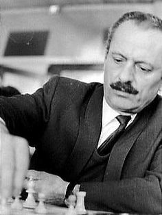 Nicolas Rossolimo (1910– 1975) was an American-French-Russian-Greek chess Grandmaster. He was many times champion of Paris, France, and after relocating to the United States won the 1955 U.S. Open Championship. He earned many brilliancy prizes for his games, authored two chess books, and ran a popular chess studio in New York. https://www.youtube.com/watch?v=c4blP368ZZs