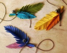 DIY colorful felt feathers above.