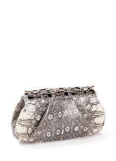 Ring Lizard Clutch from the Darby Scott Art Deco Collection. Evening clutch crowned with onyx accents in an art deco inspired toplock. Magnetic closure, fully lined, inside zipper compartment. Black a