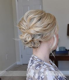 Messy side up-do. Even though she has short hair, I will try this when I get home!