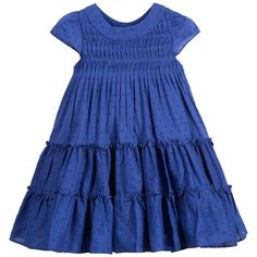 Very pretty, blue, tiered cotton dress by Lili Gaufrette in with delicate textured dots. The dress has a wide round neckline with sweet capped sleeves and ruching across the chest. With two tiers around the wide skirt, the dress fastens with beautiful little blue mother-of-pearl buttons at the back and is fully lined in soft, fine cotton for comfort. A fabulous dress for a summer's day, teamed with fuchsia pink sandals.