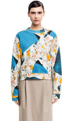 August 2014 Acne Studios: Bird Terrazzo / Terazzo Print Sweatshirt / Top. 78% Cotton 22% Polyester. Runs very large. May want to size down by one or two sizes. Available at Saks Fifth Avenue Online for $280.