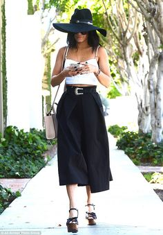 The sun's not going to ruin her complexion: Vanessa Hudgens made sure her face was in deep shade thanks to a black hat with a wide brim as she strolled in Beverly Hills on Friday