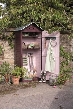 Tool shed in pretty Cuprinol Garden Shades: Summer Damson and Sweet Pea