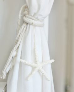 A Coastal White Weekend at the Beach Cottage, hang mini buoy from Maine instead of shell.