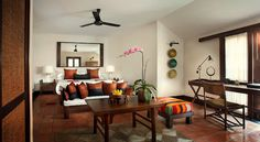 Stunning use of colors and thai style decoration for a living room