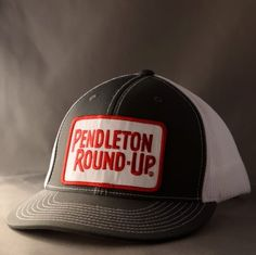 099106ff811 Pendleton Round-up Flat Billed Trucker Hat.Red embroidered patch on front.  Available