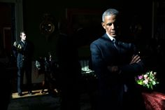 """With sunlight streaming through a window in the Green Room, President Obama listens to his introduction by Mark Barden, whose 7-year-old son Daniel was killed during the 2012 shooting at Sandy Hook Elementary School in Newtown, Conn. Later, as he made remarks in the East Room, he began to cry as he recalled the day of the shootings; he called it the worst day of his Presidency,"" Jan. 5, 2016."