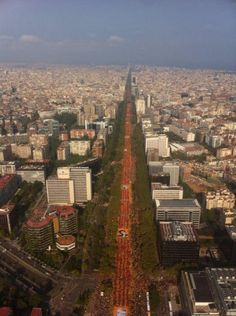 """The most stunning photo of the V for Catalonia's National Day - vilaweb.cat, 12.09.2014. Two massive Catalan flags created by hundreds of thousands of demonstrators filled the Diagonal and the Gran Via, coming together at 5:14 p.m. at the vortex located in Plaça de les Glòries, thus forming a giant V to demand independence and demonstrate the will to hold a referendum on 9 November. At the head of the demonstration was a banner with the message 'On 9-N we vote. On 9-N we win""""."""