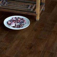 Tuscan Elite Brushed & Lacquered - Cappuccino. This dark chocolate coloured Oak floor has been brushed to raise the grain, stained to give a light warmth and then lacquered to protect creating a beautiful textured board.