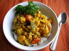 Simple Chickpea Curry - An easy recipe for vegetarian Indian food using chickpeas, tomatoes, spinach, and cauliflower.