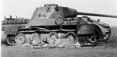 Panther Ausf. D brewed up. The fire was so intense inside the vehicle that the vehicle is sitting on its belly. The torsion bars were heated hot enough to weaken them.