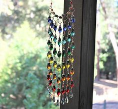 sun catchers made with old jewelry - Google Search Nevada City California, Old World Charm, Old Jewelry, Sun Catcher, Garden Crafts, Bead Caps, Victorian Homes, Wire Wrapped Jewelry, Victorian Fashion