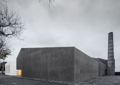 Arts centre pairs white-rendered concrete with volcanic stone